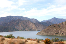 View Of Half Of Pyramid Lake With Cloudy Blue Sky Background. Pyramid Lake Offers Boating, Fishing, Jet Skiing, And Picnic Areas, Including Five Unique Sites That Are Accessible Only By Boat