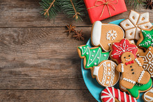 Flat Lay Composition With Tasty Homemade Christmas Cookies On Wooden Table. Space For Text