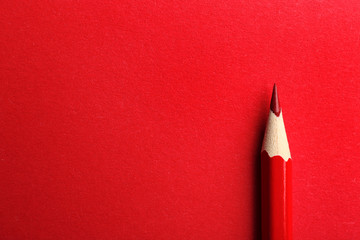 Color pencil on red background. Space for text