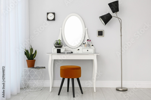 Fotografie, Obraz Dressing table with mirror in stylish room interior