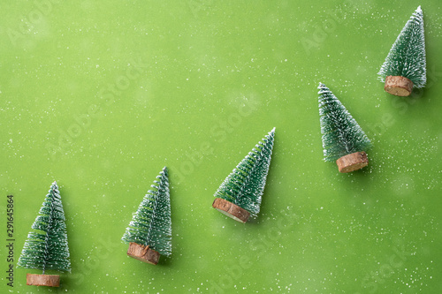 Merry Christmas and Happy New Year concept. green christman tree on green lime background with snow falling .mockup holiday celebration greeting card with copy space