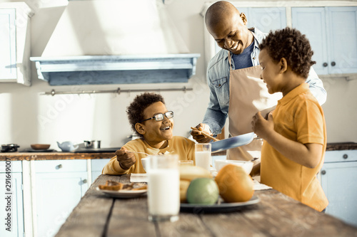 Keuken foto achterwand Kruidenierswinkel Dad with two sons coming to the summer house to relax.