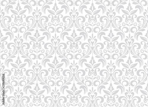 Wallpaper in the style of Baroque. Seamless vector background. White and grey floral ornament. Graphic pattern for fabric, wallpaper, packaging. Ornate Damask flower ornament. - 291649056