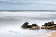 Storm In The Sea, Big Foamy Waves Crash On Rocks