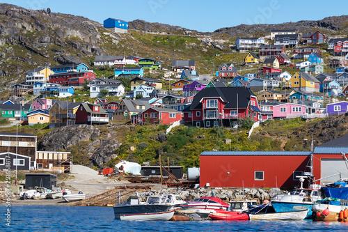 Fotobehang Noord Europa Colored houses on rocky hills in the coastline of Qaqortoq, Greenland.