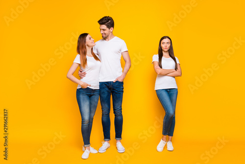 Fotografiet  Full size phot of sullen girl looking at sweethearts cuddling wearing white t-sh