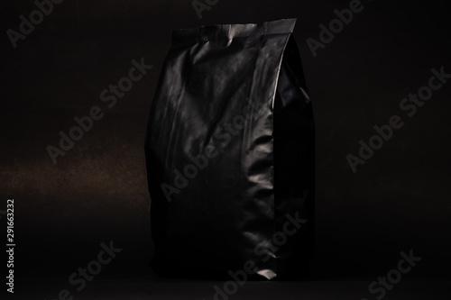 Photo  black coffee bag package on black background