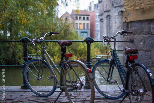 Fotobehang Fiets Ghent, Belgium; 10/29/2018: Rear part of two classic comfort bikes parked with a defocused background