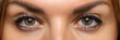 Detailed view of pretty amazing female eyes on happy and excited face