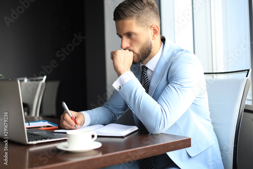 Photo sur Toile Oiseaux sur arbre Modern businessman thinking about something while sitting in the office