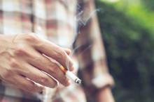 Man Holding Smoking A Cigarett...