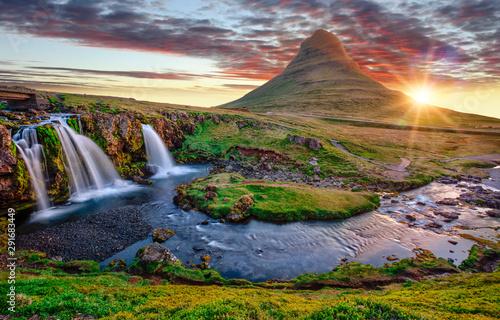 Beautiful landscape with sunrise on Kirkjufellsfoss waterfall and Kirkjufell mountain, Iceland, Europe. - 291683449