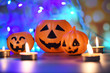 canvas print picture - Halloween background candlelight orange decorated holidays festive concept - funny faces jack o lantern pumpkin halloween decorations for party accessories object with candle light bokeh