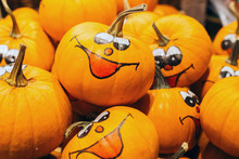 Smiley Faces Painted On Fresh Pumpkins In The Autumn. Halloween