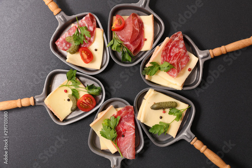 Fototapeta  assorted of spoon with cheese raclette, salami and tomato