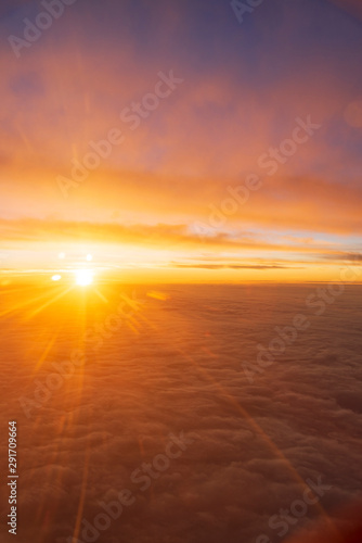 Fotobehang Zandwoestijn the sea of cloud sunset sky background from window airplane