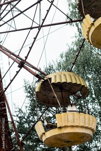 metallic ferris wheel in green amusement park in chernobyl