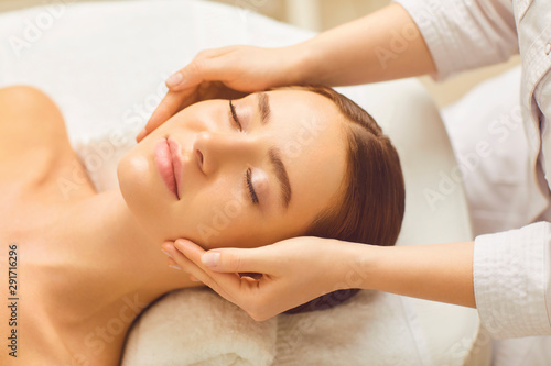 Spoed Foto op Canvas Ontspanning Face woman massage relax close up in a beauty clinic.