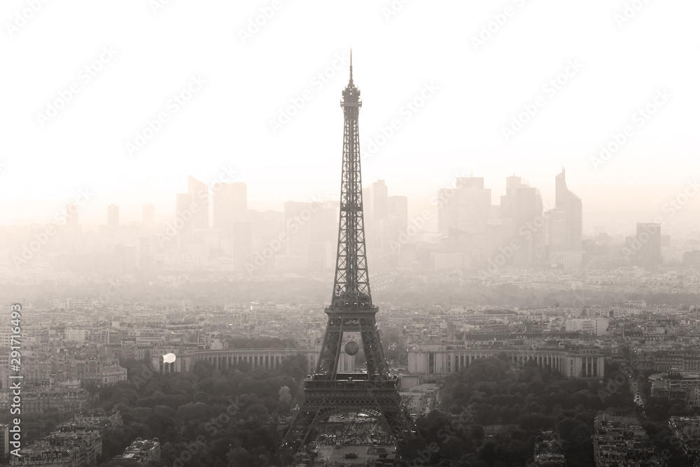 Fototapety, obrazy: Aerial view of Paris with Eiffel tower and major business district of La Defence in background at sunset.
