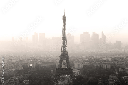 Aerial view of Paris with Eiffel tower and major business district of La Defence in background at sunset. - 291716493