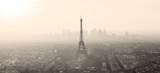Fototapeta Fototapety z wieżą Eiffla - Aerial view of Paris with Eiffel tower and major business district of La Defence in background at sunset. Sepia toned monocrome image.