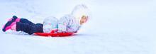 Happy Little Girl Sliding Down...