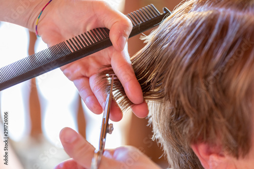 Photo  Female hair cutting scissors in a beauty salon