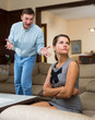 Leinwandbild Motiv Male and female quarreling at home