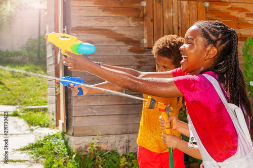 Action image of girl shoot with water gun in game