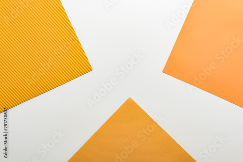 top view of bright yellow paper on white background