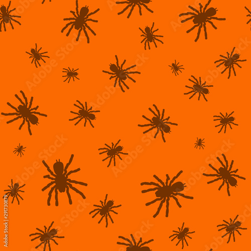 Photo Seamless pattern with black silhouette of spider on orange background