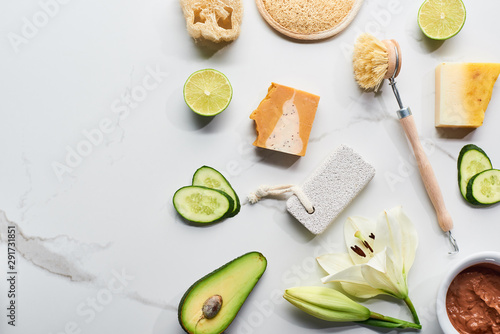 Obraz na plátně  top view of natural soap pieces, body brush, loofah and pumice stone near fresh