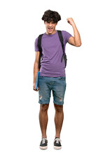 A Full-length Shot Of A Young Student Man Celebrating A Victory Over Isolated White Background