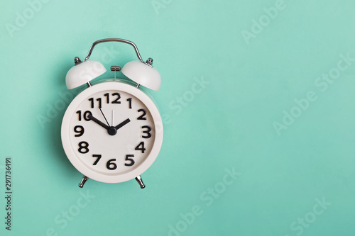 Vintage alarm clock isolated on pastel mint background, Wallpaper Mural