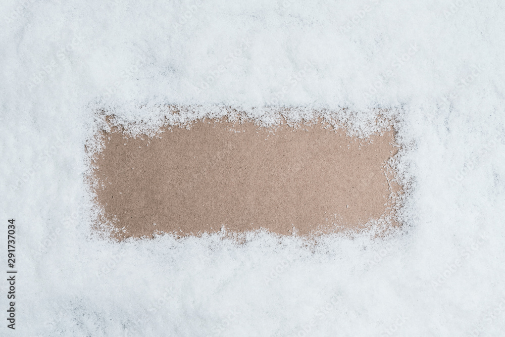 Fototapety, obrazy: View from above. snow texture. craft paper in the middle with copy space for text. Concept