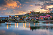 Wurzburg, Germany. Cityscape Image Of Wurzburg With Old Main Bridge Over Main River And Marienberg Fortress During Beautiful Autumn Sunset.