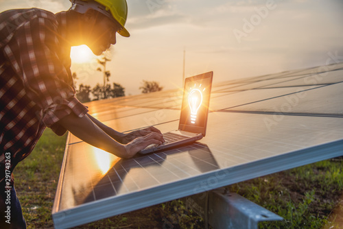 The engineer is checking the solar cell power system. - Image