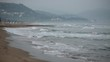 Waves at sea. Storm in the ocean. Italian coast of the Tyrrhenian Sea. Morning twilight with fog.