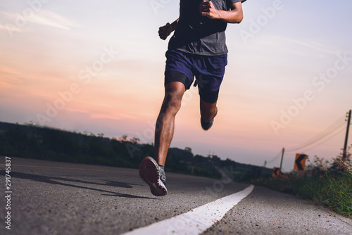 Cuadros en Lienzo Athlete runner feet running on road, Jogging concept at outdoors