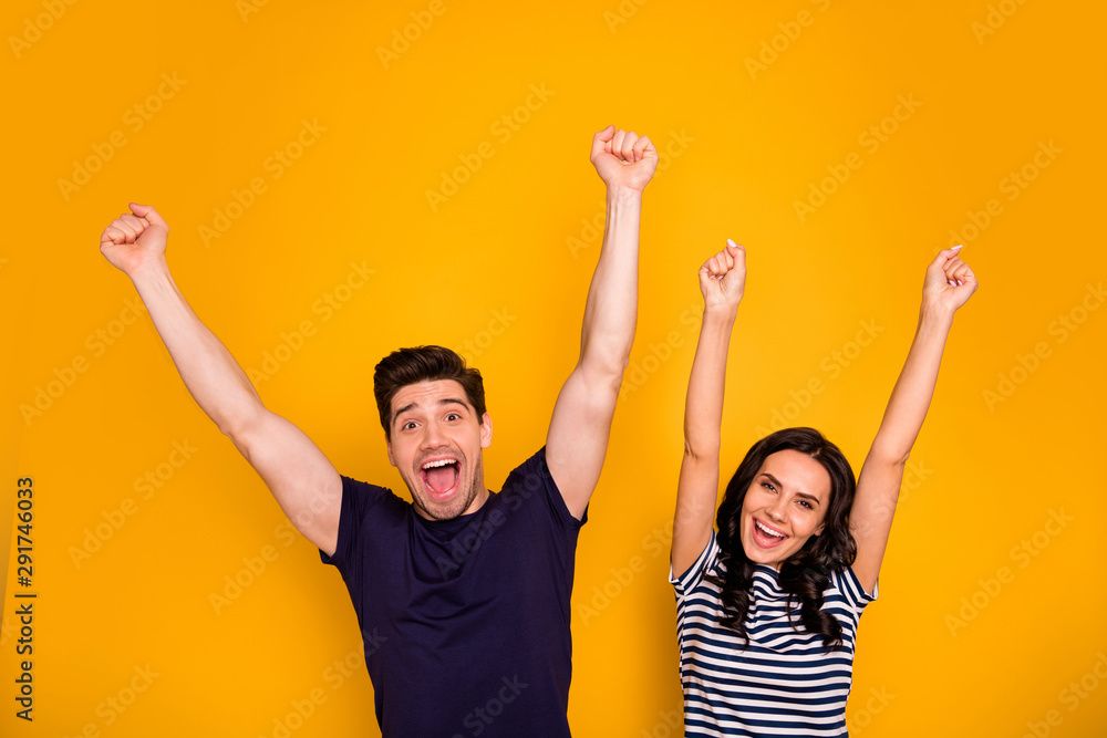 Fototapeta Portrait of his he her she nice-looking attractive lovely cheerful cheery people married spouses rising hands up having fun time holiday isolated over bright vivid shine yellow background