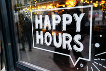 White 'happy Hours' Sign On Restaurant Window With Beautiful Bokeh Balls In The Background