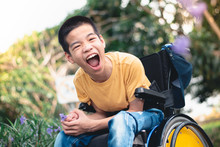 Disabled Child On Wheelchair I...