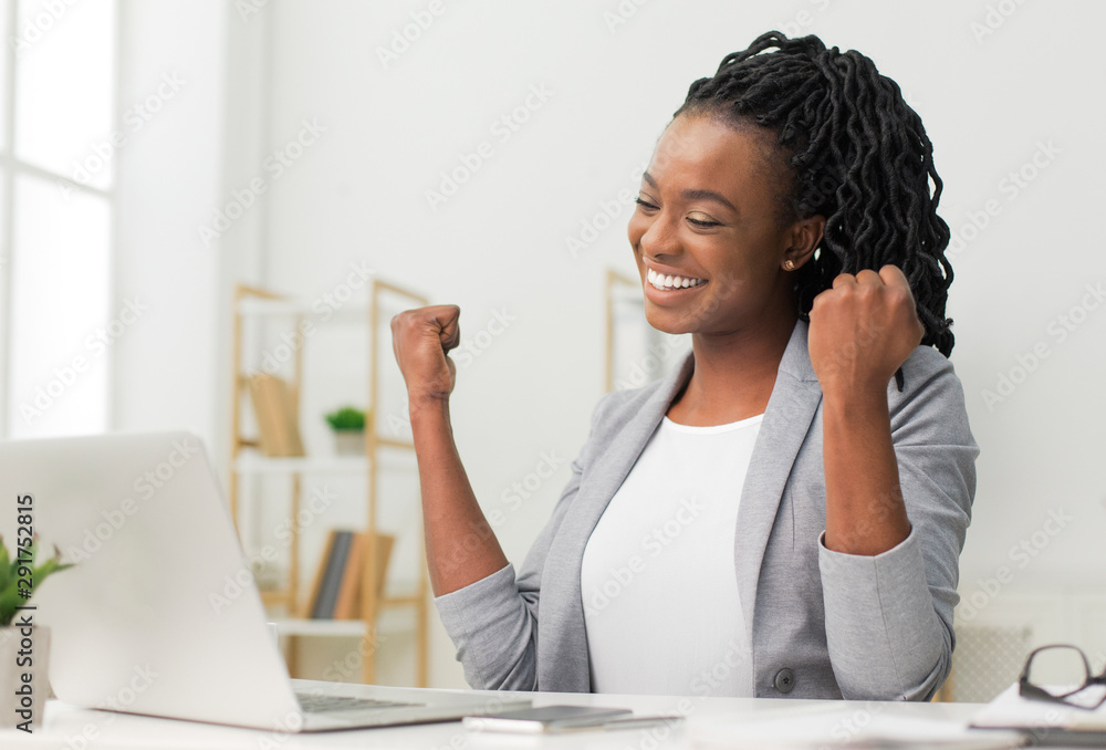 Fototapety, obrazy: Black Lady Celebrating Business Success Sitting At Laptop In Office