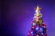 canvas print picture Christmas tree with festive lights, purple background