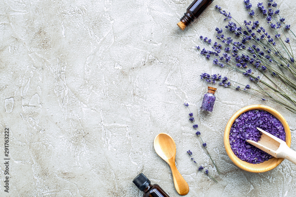 Fototapety, obrazy: Essential oil and lavender salt with flowers top view
