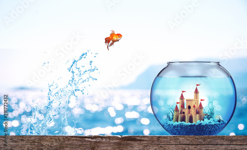 Goldfish leaps from the sea to go to a luxurious aquarium with castle Canvas-taulu