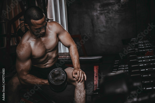 Portrait of asian man big muscle at the gym,Thailand people,Workout for good hea Canvas Print