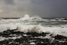 Big Waves Crashing Near A Rocky Shore