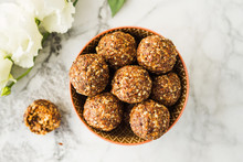 Energy Protein Balls With Healthy Ingredients On Marble Table. Home Made With Dates, Peanut Butter, Flax And Chia Seeds, Oats, Almond And Chocolate Drops
