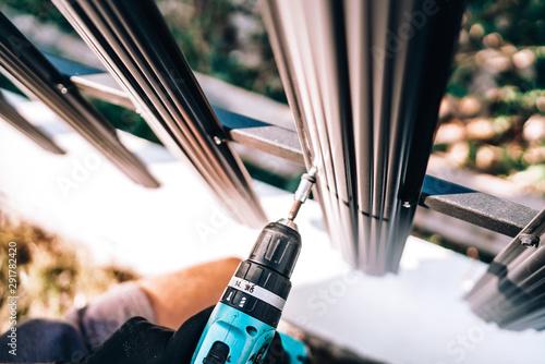 Close up details of construction worker using electrical screwdriver for fasteni Tapéta, Fotótapéta